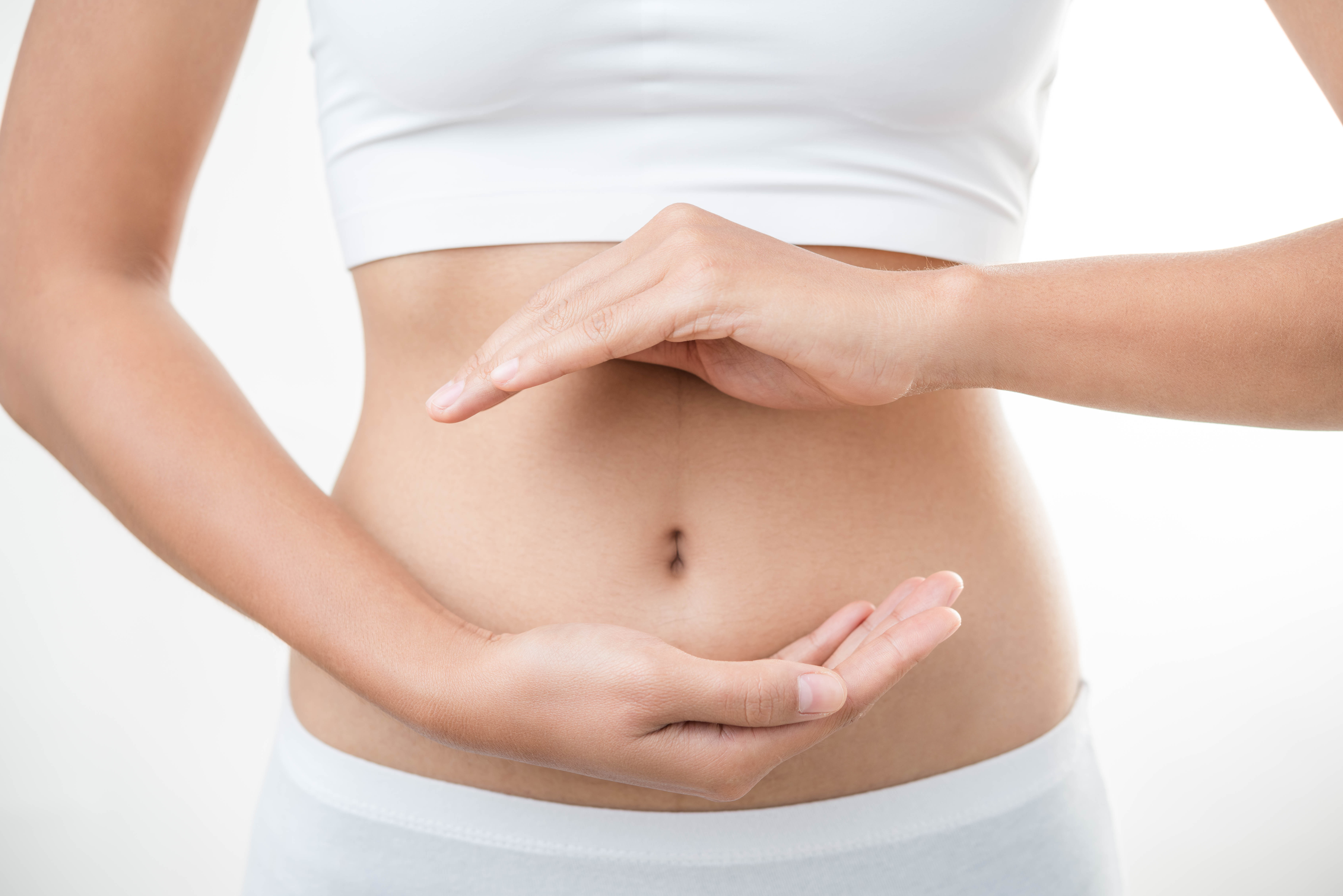 woman with hands over abdomen